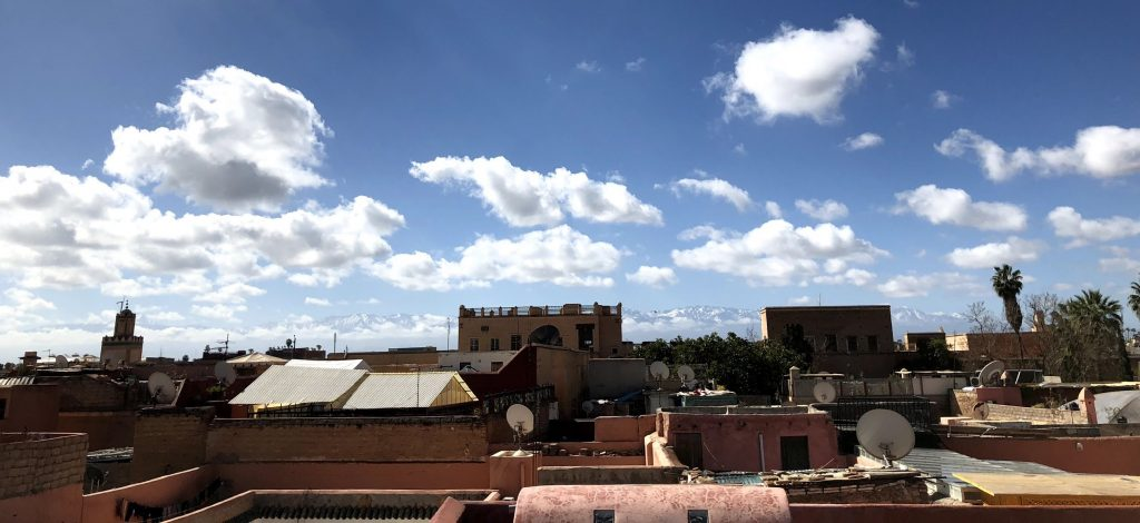 View from the roof terrace to the snow-covered peaks of the Atlas Mountains