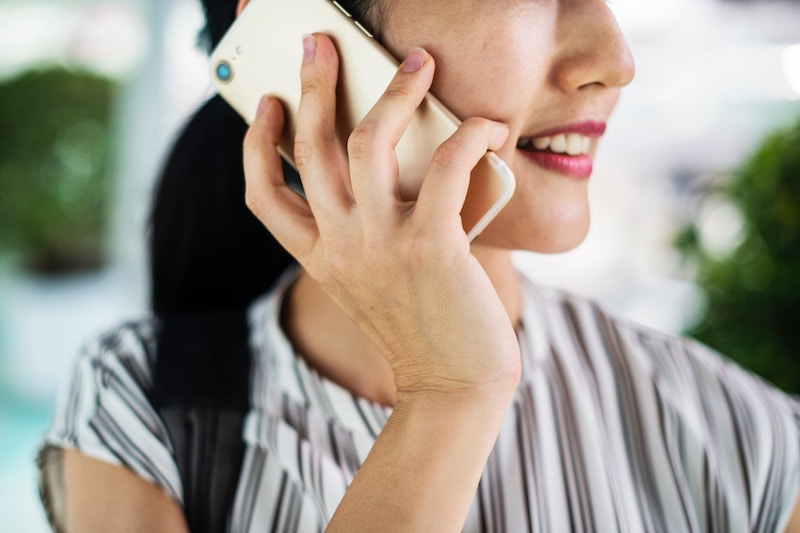 Sales people of the future: Woman on the phone with mobile phone